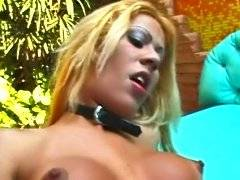 Excited blonde transsexual in collar blowjob fun