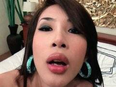 Lovely ladyboy in sexy lingerie dildoing on bed